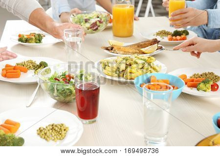 Family having lunch in kitchen, closeup