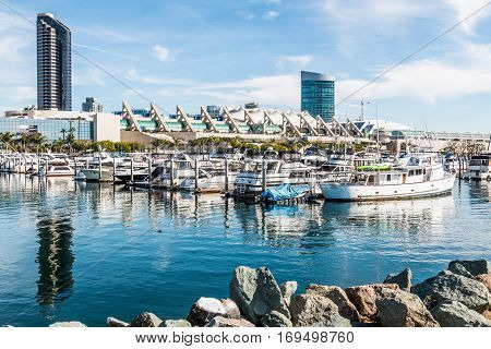 SAN DIEGO, CALIFORNIA - JANUARY 8, 2017:  Convention center, surrounding hotels and yachts docked at Embarcadero Marina Park North.