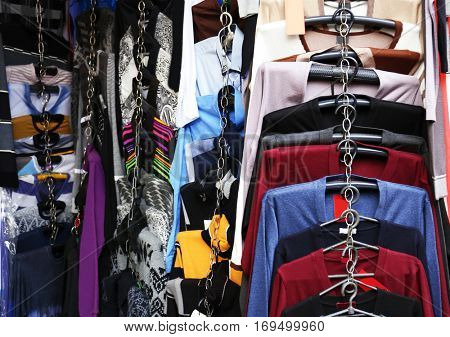 Clothes on rail in clothing store