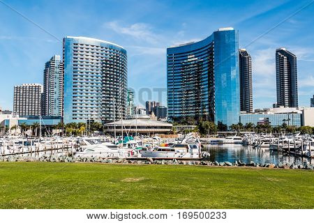 SAN DIEGO, CALIFORNIA - JANUARY 8, 2017:  Yachts docked with nearby hotels at Embarcadero Marina Park North.