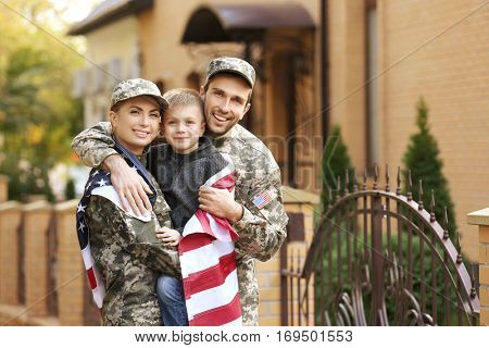 Military family reunited on a sunny day