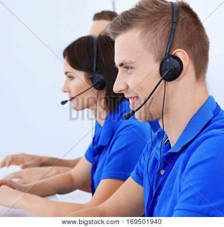 Friendly team of technical support dispatchers working in office
