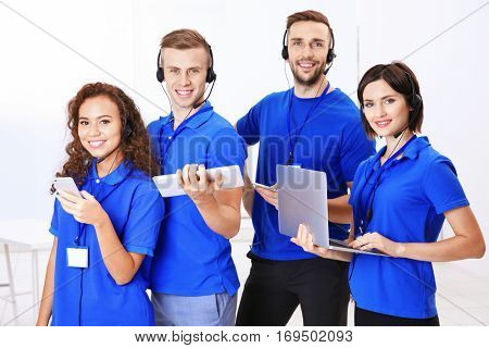 Team of friendly technical support dispatchers in office