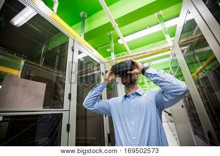 Technician using virtual reality headset in server room