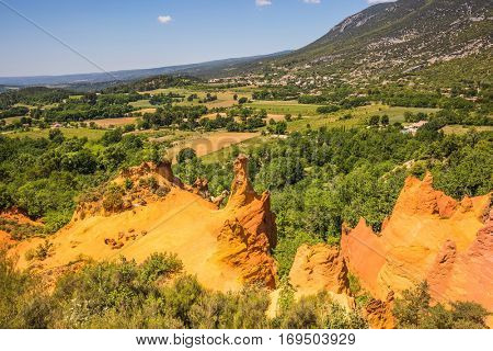 Orange and red picturesque hills. Reserve - quarry for ocher mining. Languedoc - Roussillon, Provence, France