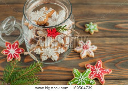 Christmas gingerbread cookies in jar on wooden table.