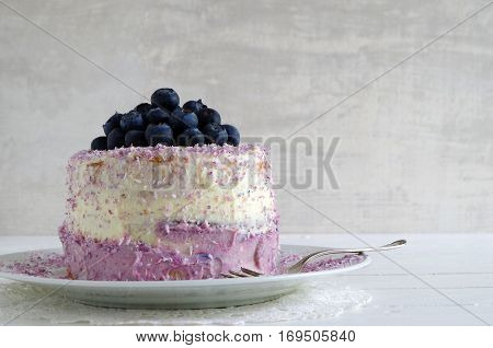 fresh home made bluebarry cake with purple cream cheese and coconut flake