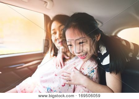 Happy kid and mother travelling in car.