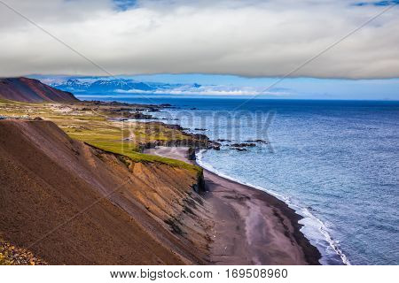 The main highway in Iceland on the Atlantic coast. Summer tour in the Nordic countries. The concept of extreme northern tourism