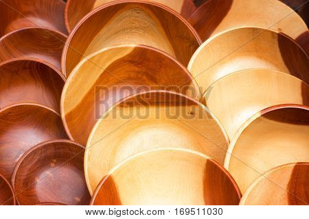 Rows of carved teak wood bowls. Hand crafted souvener giftware at a market in South Africa.