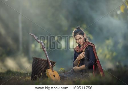 Happy Asian Woman In Traditional, She Sing A Song And Play Pin (thai Akulele)