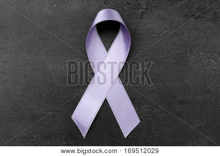 Lavender ribbon on dark background. Cancer and epilepsy concept