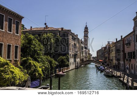 medieval architecture, houses, bridges, squares and boats on the canal-streets of Venice, Italy