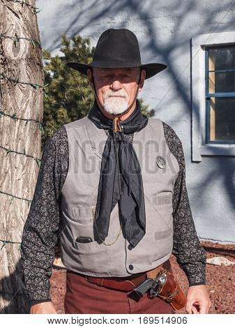 A Man In Cowboy Outfit