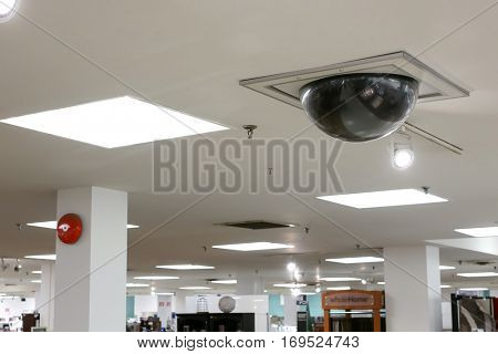 Burnaby, BC, Canada - December 06, 2016 : Dome security camera on top of ceiling inside Sears store