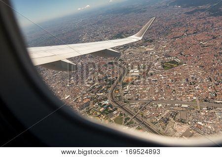 Sao Paulo city seen through window of an aircraft