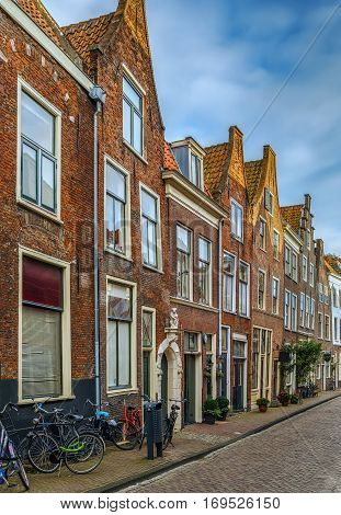 Street with historical houses in Leiden downtown Netherlands