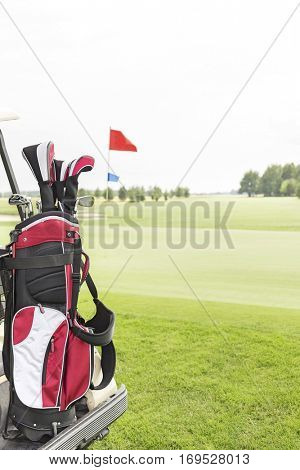 Golf club bag at golf course against clear sky