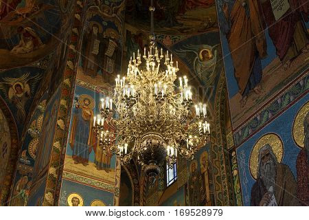 SAINT-PETERSBURG RUSSIA - JANUARY 05 2017: Chandelier and mosaic on the walls of the Church of the Savior on Blood in Saint-Petersburg.