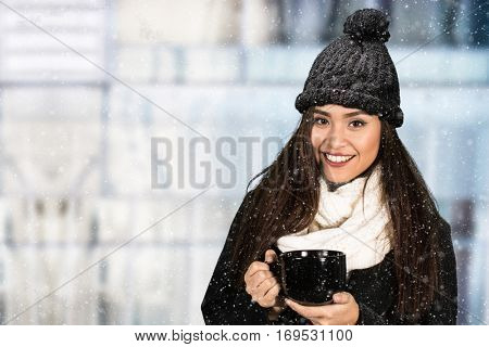 Young woman outside in the snow during winter