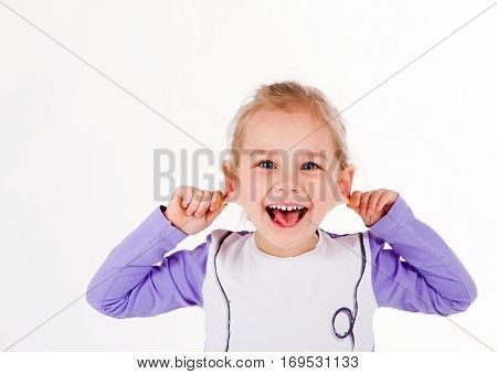 funny cute baby girl showing tongue and pulls his ears, fooling around and indulge. isolated on white background