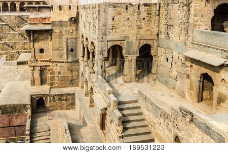 Alcoves at the Chand Baori Stepwell in Abhaneri Rajasthan India.