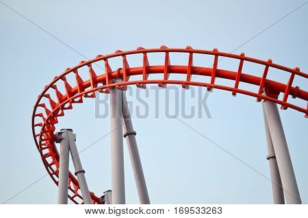 Red roller coaster in the theme park