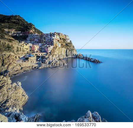 Manarola village on cliff rocks and sea seascape in Five lands Cinque Terre National Park Liguria Italy Europe.