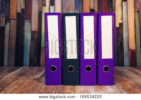 Four document ring binders with blank labels on accountant's office desk