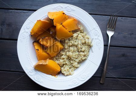 a dish of cooked pumpkin and quinoa. Top view
