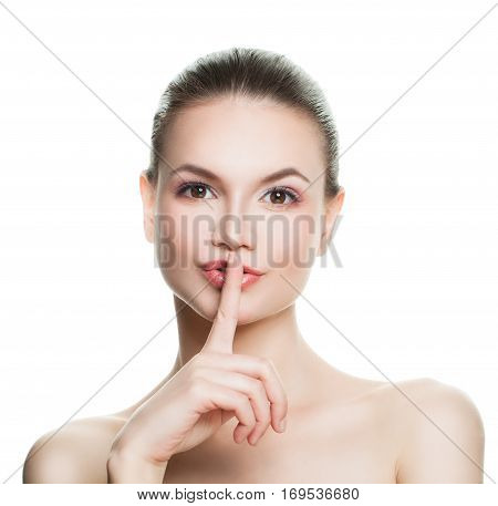 Healthy Woman Holding her Finger to her Lips in a Gesture for Silence Isolated. Silent and Shushing Concept
