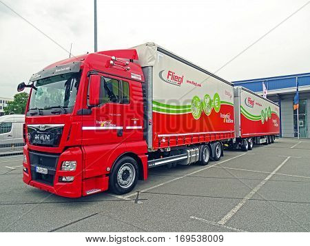 Chemnitz, Germany - October 4, 2015: A MAN truck with an overlong Fliegl EuroCombi Road Train semitrailer parked in a parking lot in Chemnitz.