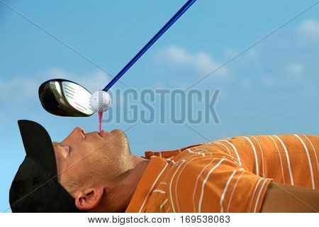 Man balancing golf ball on tee in his mouth