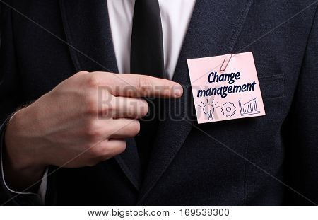 Business, Technology, Internet And Network Concept. Young Businessman Shows The Word: Change Managem