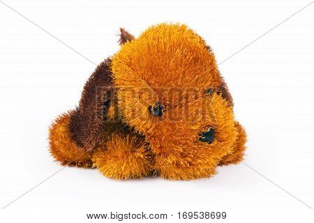 Toy brown doggie is isolated on a white background