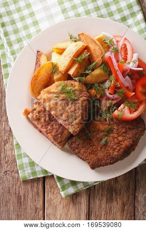Fried Rump Steak And Fresh Vegetables, Baked Potatoes Close Up. Vertical Top View
