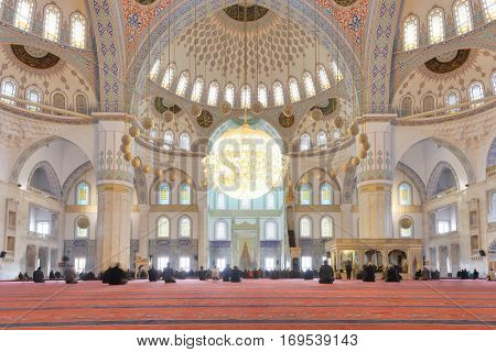 Ankara, Turkey - March 28, 2013: Kocatepe mosque interior view during prayer.  It is the largest mosque in Ankara and was built between 1967 and 1987.
