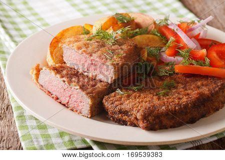 Rump Steak In Breadcrumbs And Fresh Vegetables, Baked Potatoes Close Up. Horizontal