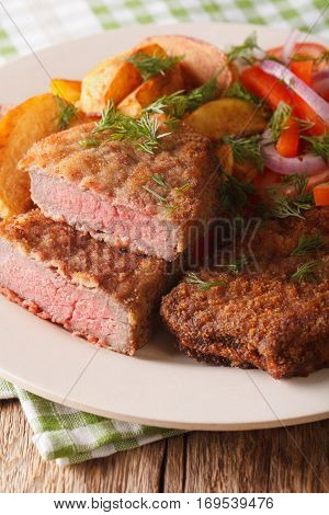 Fried Rump Steak And Fresh Vegetables, Baked Potatoes Close Up. Vertical