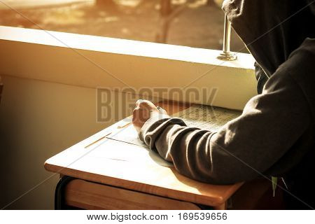 student taking in school with test paper