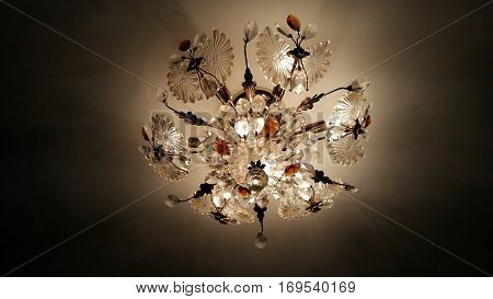 glass chandelier on a white ceiling, photographed from the bottom up