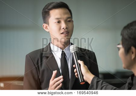 Young businessman were interviewed to reporter in conference room