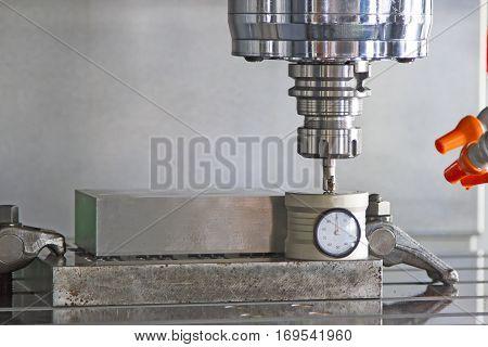CNC machining center setting tool tip after cutting metal on box set