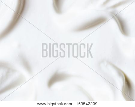 greek yogurt or sour cream texture close up with copy space. Top view or flat lay