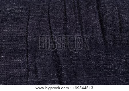 Texture of blue denim jeans fabric textile background close up
