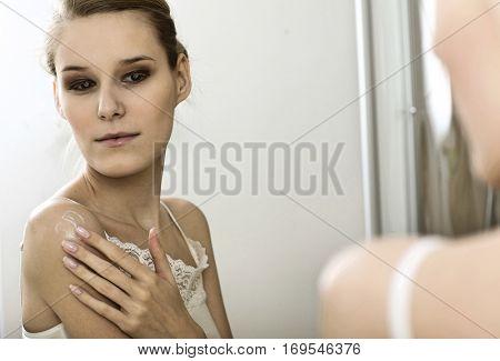 Woman reflaction in mirror