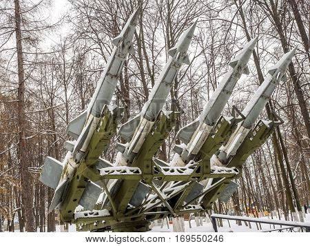 Anti-aircraft missiles bombarded day with snow in the park in winter.
