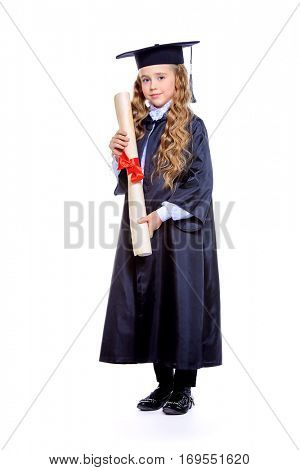 Full length portrait of a cute nine year old girl in an academic gown and hat holding a diploma. Educational concept. Isolated over white.