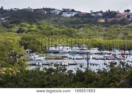 Small harbor and houses situated on the hills of Willemstad on Curacao