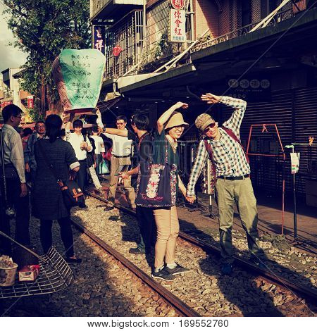 Shifen Old Street - December 2016: Tourists posing for photo on railway track after  release of sky lantern.